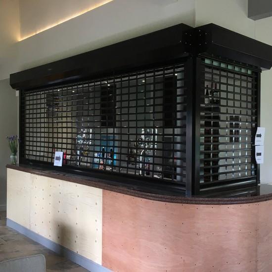 Bar Servery Shutter Punched Aluminium - 58% Vision